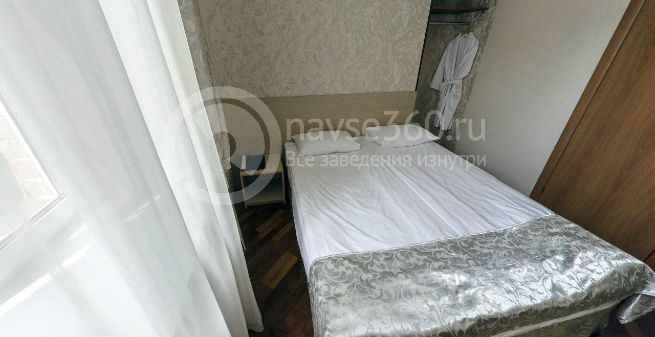 Спальня номера люкс в отеле ИнтернационалЪ